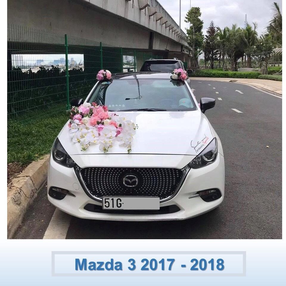 xe hoa Mazda 3 màu trắng
